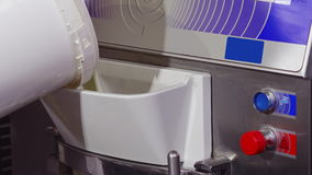 Filling freezer with milk mix for ice cream production stock video