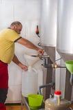 Filling fresh olive oil Stock Images