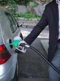 Filling gas. A man filling gas on his car Stock Images