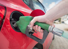 Filling Gas. Male hand filling gas close up royalty free stock images
