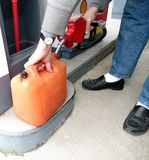 Filling the Gas Can. At the gas station royalty free stock images