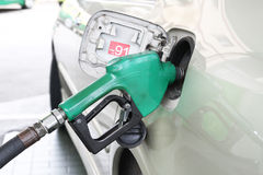 Filling gasoline. Car is filling gasoline at gas station Stock Photo