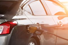 Filling gasoline in car with a nozzle. Background for your work Royalty Free Stock Photo