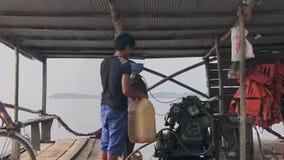 Filling gazoline, ferry, mekong,  cambodia stock video