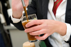 Filling a glass of beer Royalty Free Stock Image