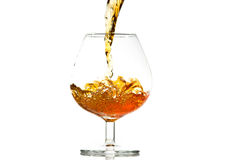 Filling a glass of brandy Stock Photography