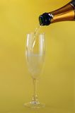 Filling a glass with Champagne Stock Image