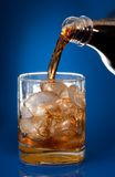 Filling glass with cola Stock Image