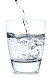 Filling a glass with pouring water Royalty Free Stock Photo