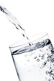 Filling a glass with pure water with bubbles Royalty Free Stock Photography