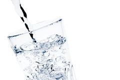 Filling a glass with pure water with bubbles and space for text. Detail of filling a glass with pure water with bubbles and space for text on white background Stock Photos