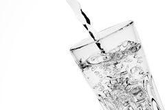 Filling a glass with pure water with space for text Stock Images