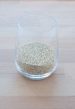 Filling a glass of quinoa grain from the Andes Royalty Free Stock Photography