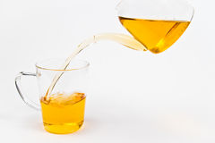 Filling a glass of tea. From top royalty free stock photo