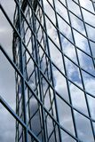 Filling glass wall of a waving building royalty free stock photography