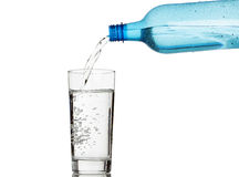 Filling a glass of water Stock Image