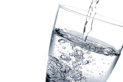 Filling a glass with water Stock Photography
