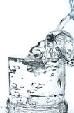 Filling a glass with water showing a drink concept Royalty Free Stock Photography