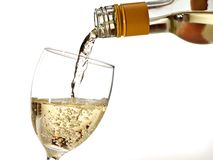 Filling glass with white wine Stock Images