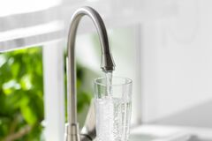 Free Filling Glass With Clear Water From Faucet Indoors, Closeup Stock Photography - 207017412