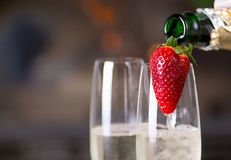 Filling glasses of champagne. Royalty Free Stock Image