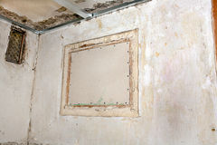 Filling the hole with plasterboard. Closing the outer holes in the wall with drywall repair in the room Royalty Free Stock Photos