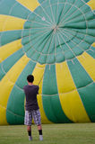Filling the Hot Air Balloon. An operator works to inflate a hot air balloon at a festival in Waterford, Wisconsin royalty free stock image