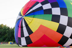 Filling the Hot Air Balloon. Operators work to inflate a hot air balloon at a festival in Waterford, Wisconsin royalty free stock photos