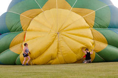 Filling the Hot Air Balloon. Operators work to inflate a hot air balloon at a festival in Waterford, Wisconsin royalty free stock image