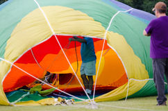 Filling the Hot Air Balloon. Operators work to inflate a hot air balloon at a festival in Waterford, Wisconsin stock images