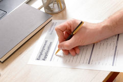 Filling inblank employment application form Stock Image