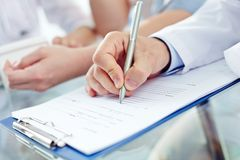 Filling in medical form Royalty Free Stock Photography