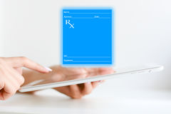 Filling a medical prescription online with a tablet device Stock Image