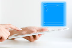 Filling a medical prescription online with a tablet device Stock Photo
