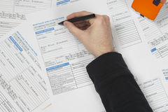 Filling in mortgage application Stock Photos