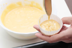 Filling muffins Stock Images