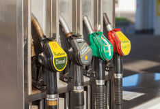 Filling nozzles at a Shell gas station. BURG / GERMANY - NOVEMBER 13, 2016: Filling nozzles at a Shell gas station. Shell is an Anglo-Dutch multinational oil and stock image