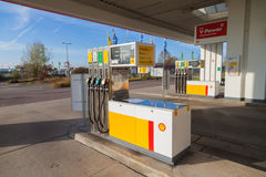 Filling nozzles at a Shell gas station. BURG / GERMANY - NOVEMBER 13, 2016: Filling nozzles at a Shell gas station. Shell is an Anglo-Dutch multinational oil and stock photography
