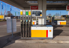 Filling nozzles at a Shell gas station. BURG / GERMANY - NOVEMBER 13, 2016: Filling nozzles at a Shell gas station. Shell is an Anglo-Dutch multinational oil and stock photos