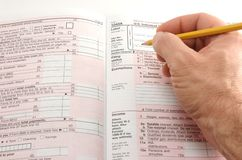 Filling out 1040a Royalty Free Stock Photography