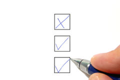Filling out a check box. On a white background Royalty Free Stock Photos