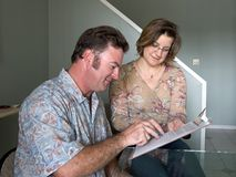 Filling Out Forms. A job applicant filling out forms with help from a woman royalty free stock image