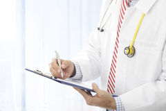 Filling out medical document Royalty Free Stock Photography
