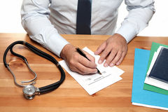 Filling out prescription Stock Photo