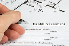 Filling out a rental agreement with floorplan Royalty Free Stock Images
