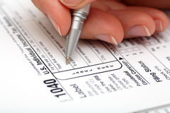 Filling out tax form Royalty Free Stock Photo