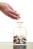 Filling pills in glass Stock Images