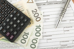 Filling in polish individual income tax form PIT. With money and pen Royalty Free Stock Photos