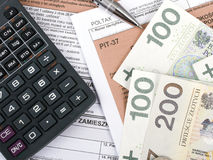 Filling in polish individual income tax form PIT. With money and pen Stock Photos