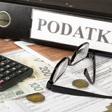 Filling in polish individual income tax form PIT. With money and pen Stock Images